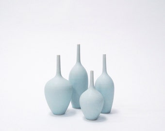 MADE TO ORDER- 4 small stoneware bottle vases in ice blue matte glaze by sarapaloma . mid century modern ceramics and pottery vases bud vase