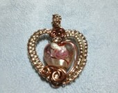 Small and delicate pink heart pendant wrapped in rose gold craft wire