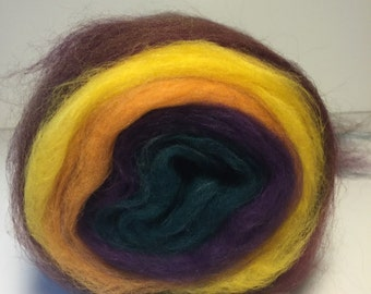 Merino wool self striping center pull roving bump. Tons of color changes Weighs 4.5oz Free  Ship