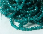 Candy jade faceted round dark lake blue 15-inch strand (item ID CJ4mRBB)