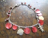 Her Rosy Cheeks Mother of Pearl and Glass Charm bracelet