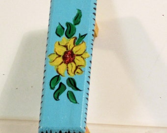 Minature wooden painted bench or stool in the mexican style