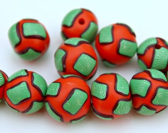 Handmade Artisan Polymer Clay Bead Set in Rich Orange Red With Green White and Purple