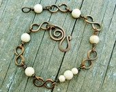 Copper Infinity Links and Riverstone beads bracelet wire wrapped in antiqued copper