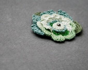 Freeform crochet brooch in shades of green
