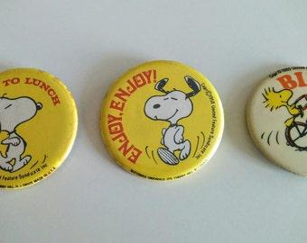 Three vintage 70s Snoopy Peanuts pinbacks - as is condition