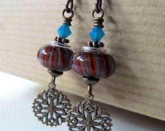 Red, Orange and Blue Lampwork and Teal Crystal Beaded Niobium Earrings