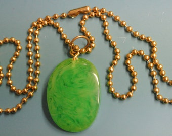 Pendant necklace with genuine tested vintage 1950s flamy swirled light grass green tested bakelite plastic bead and brass ball chain