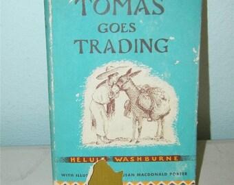 Vintage Tomas Goes Trading Childrens Book Heluiz Washburne Hardcover 11340
