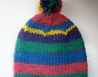 Unisex child's beanie pompom hat wool rich yarn hand knitted Classic design Contemporary colours  - blue, green, yellow, pink