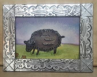Folk art sheep and frame