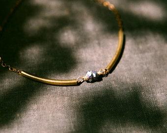 Raw gemstone geometric necklace with golden brass tubes. Rainbow titanium citrine druzy crystal on antiqued brass chain