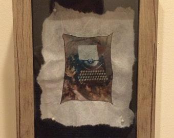 Polaroid emulsion lift - framed original Typos in gray frame