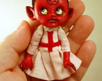 Satan's little angel festive dead ornament by Kamila Mlynarczyk Woodedwoods