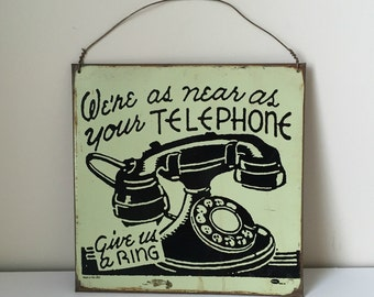 vintage metal telephone sign