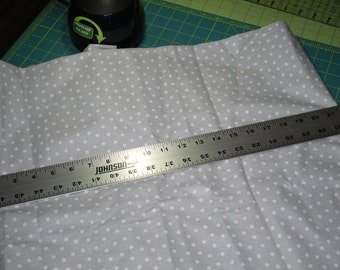 Light grey with white dots fabric.... 100% cotton.... 44 to 45 inch wide ... by the yard