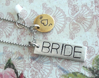 The BRIDE Charm Necklace . Accent Charms and Crystals . Hand Stamped customize antiqued disc metals. Skinny pendants in Copper, Silver, Gold