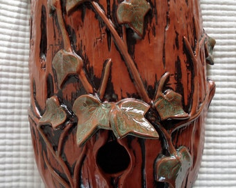 Terracotta Ivy Log Wall Sconce functions as Planter/Birdhouse with red iron wash
