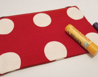 Small red polka dot pouch