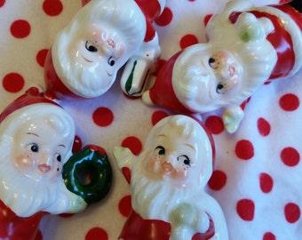 Four sweet and cute Santa figurines