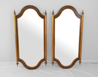 hollywood regency gilded finial topped tall mirrors