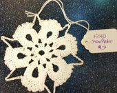 Hand crocheted snowflake ornament #15540
