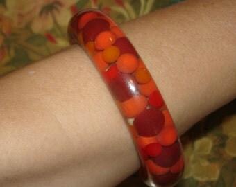 fun vintage suspended orange and red balls polka dot bangle bracelet