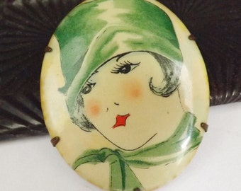 Vintage Art Deco celluloid flapper portrait brooch or pin lady in green cloche