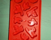 Vintage Orange Bendable plastic Halloween candy mold makes 12 different molds