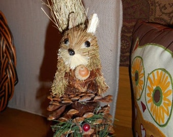 Animal with acorn sitting on a pine cone Christmas ornament or decoration