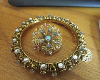 gold gemmed bangle with snowflake brooch