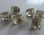 Vintage Button - 6 matching emerald cut set in silver metal small solitaire rhinestones  ( oct 62)