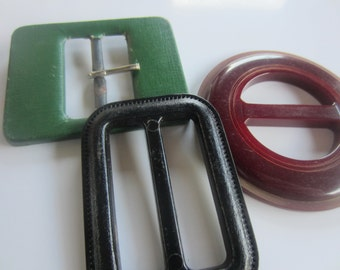 Vintage belt buckles, 3  (2) early plastic, 1 coated fabric and metal large assorted, green, brown and black (OCT 36)