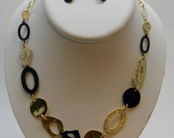 gold and black shapes