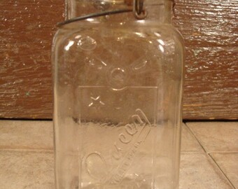 Vintage glass Queen 1 quart canning jar with embossed marking