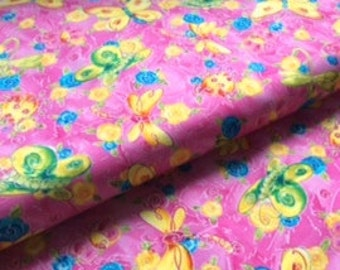 Cute butterfly and flowers print from Camelot Cottons:  1/2 yard