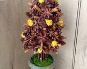 Woodland tree topiary with Pinecones, cinnamon and dried Roses.