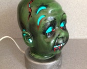 Free shipping Creepy green doll head Halloween lighted Zombie head #1021
