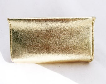 Donna - 1970s gold clutch