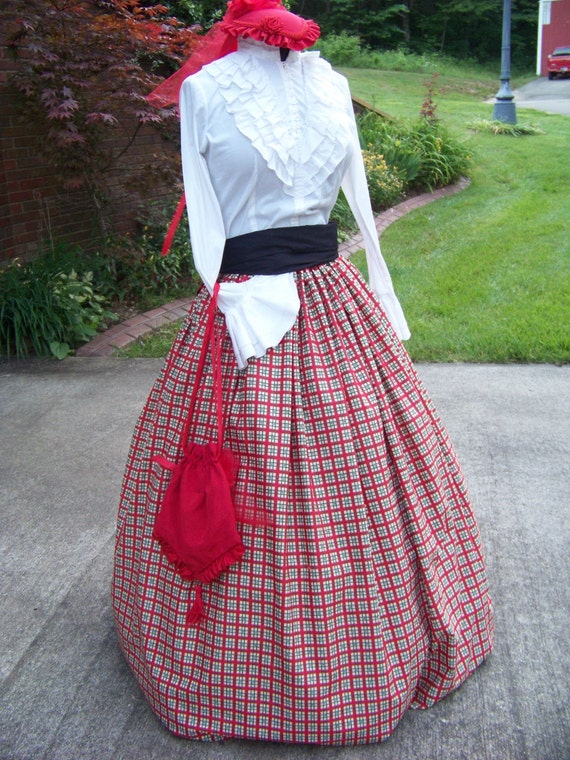 Victorian Skirts | Bustle, Walking, Edwardian Skirts Dickens Christmas Long Skirt and sash one size fit all Green Red ivory and black  plaid cotton $34.99 AT vintagedancer.com