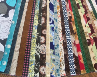 Jelly Roll Fabric Designs with Two Free Strips