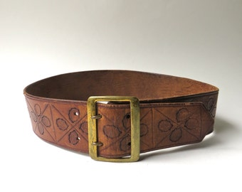 60s vintage Boho Rustic Hand Tooled Wide Brown Leather Belt with Double Prong Brass Buckle / At The Sign Of The Boot Williamsburg, Virginia