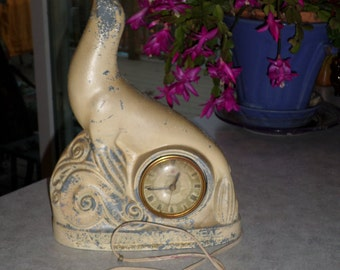 Carstairs White Seal Whiskey Bronzart P. Sullivan cast metal large SEAL CLOCK with red lucite BALL circa 1938