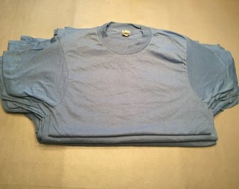 Vintage Screen Stars paper-thin light blue 50 cotton/50 polyester t-shirts, 1980s deadstock.