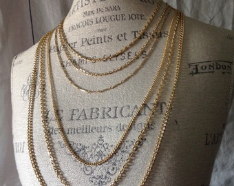 Vintage multi strand assorted style gold tone chains necklace