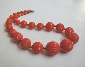 Vintage orange textured beaded necklace with gold tone accents