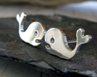 Whale stud earrings with a heart tail.  Handcrafted from sterling silver or 14k gold. Moby Dick jewelry. Ocean beach gift. Childrens.