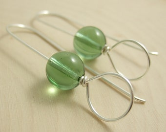 Earrings with a Long Line, Circle and Mint Green Glass Bead CHE-245
