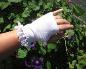 White finger-less formal bridal gloves are handmade crochet lace from Ohio