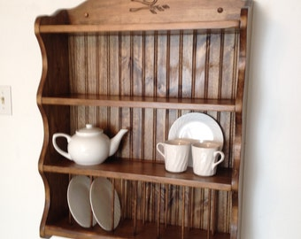 Tea set collection, shelf.